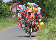 Balloons. Merchants hawked balloons with a bike in the city of Solo, Central Java, Indonesia Stock Photography