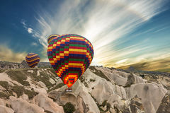Balloons in mountain, Cappadocia, Turkey Stock Images