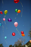 Balloons. The multi-colored balloons departing to the blue sky Stock Photography