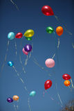 Balloons. The multi-colored balloons departing to the blue sky Royalty Free Stock Images