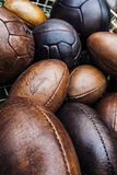 Balloons. Old football and soccer leather ballons stock images