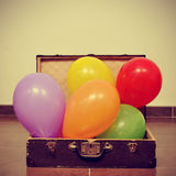 Balloons in an old suitcase Royalty Free Stock Photography