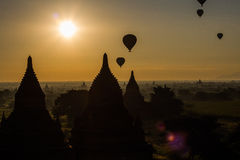 Balloons over Bagan. Myanmar - sunrise with balloons flying over Bagan  is an ancient city located in the Mandalay Region of Burma (Myanmar Stock Photo