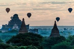 Balloons over Bagan and the skyline of its temples, Myanmar. Dhammayangyi Templ