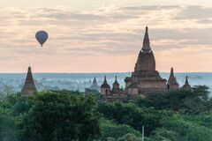 Balloons over Bagan and the skyline of its temples, Myanmar. Myauk Guni Templ