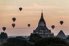 Balloons over Bagan and the skyline of its temples, Myanmar. Sulamani temple and Shwesandaw pagod