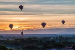 Balloons over Bagan with viewing tower, Myanm