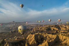 Balloons over a dramatic landscape Royalty Free Stock Image