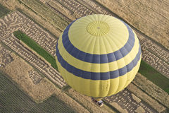Balloons over Farmland. Hot air balloons over the farmland in Luxor,Egypt royalty free stock images
