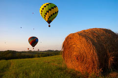 Balloons Over Iowa. Hot air balloons fly over an Iowa landscape stock photos