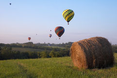 Balloons Over Iowa. Hot air balloons fly over an Iowa landscape Royalty Free Stock Photography