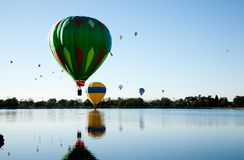 Balloons over lake Stock Images