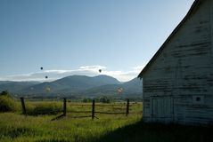 Balloons over Steamboat Springs. Hot air balloons in the 30th annual Hot Air Balloon Rodeo in Steamboat Springs ascending into the Colorado sky royalty free stock image