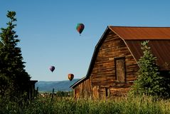 Balloons over Steamboat Springs. Hot air balloons in the 30th annual Hot Air Balloon Rodeo in Steamboat Springs ascending into the Colorado sky royalty free stock images