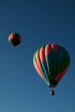 Balloons over Steamboat Springs. Hot air balloons in the 30th annual Hot Air Balloon Rodeo in Steamboat Springs ascending into the Colorado sky stock image