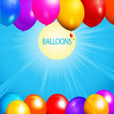 Balloons over sunny sky background Stock Image