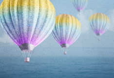 Balloons over watercolor sea landscape paper grunge background