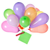 Balloons and a post-it-note on white background. Bunch of balloons with a note pinned to the knot with a peg on white background Stock Photography