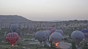 Balloons prepare for take-off before sunrise stock video footage