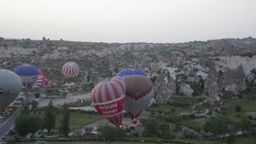 Balloons prepare for take-off before sunrise. stock video