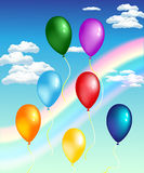 Balloons with rainbow.  beautiful card with balloons on a background of blue sky and rainbow Stock Photo