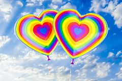 Balloons with rainbow LGBT flag in the shape of heart, 3D render. Balloons with rainbow LGBT flag in the shape of heart, 3D Royalty Free Stock Photos