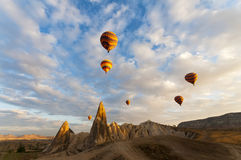 Balloons rising in sunrise in Cappadocia Turkey Stock Photos