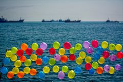 Balloons at seaside. A game with balloons at seaside. With a toy gun trying to hit a balloon Royalty Free Stock Image