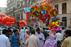 Balloons Seller. A man balloons selling stand on the road side and selling multicolors birds balloons like tiger hen, cock, doreamon, parrot Stock Image