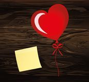 Balloons in the shape of heart bandaged with ribbon and bow, for. A holiday and birthday and a party. Empty yellow sheet of paper for notes. Sticker. Red Stock Images