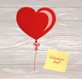 Balloons in the shape of heart bandaged with ribbon and bow, for. A holiday and birthday and a party. Yellow sheet of paper for notes. Sticker. Red inflatable Royalty Free Stock Photography