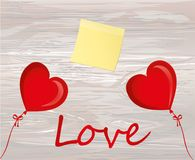 Balloons in the shape of heart bandaged with ribbon and bow. Emp. Ty Yellow sheet of paper for notes. Sticker. For the holiday and valentine`s day and party. Red Stock Photo