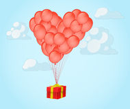 Balloons in shape of a heart with gift box Stock Photos