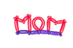 Balloons shaped into mom text. Isolated on white Royalty Free Stock Images