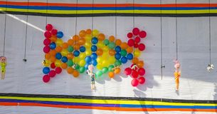 Balloons shooting on white board. With gun for kids playing royalty free stock image