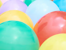 Balloons showing splendid colors closeup. Background of many colorful balloons Stock Photos