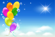 Balloons in the sky. Balloons, sky, sun and clouds Stock Photography