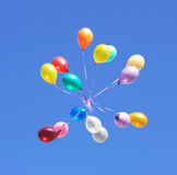 Balloons in the sky. Flying balloon after celebration in the clear blue sky Royalty Free Stock Image