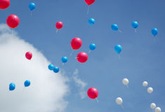 Balloons in the sky. Multi colored balloons flying up in the sky Stock Image