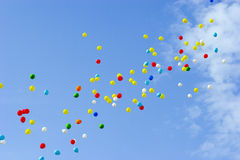 Balloons in sky Stock Images