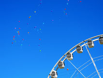 Balloons in the sky anf the ferris wheel, St. Petersburg. Russia Royalty Free Stock Images