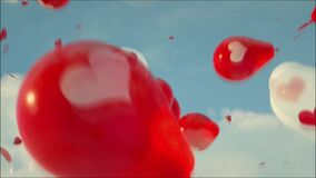 Balloons in the Sky. Balloons in the form of red and white hearts soar in the sky.