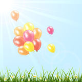 Balloons in the sky. Set of colorful balloons fly in the sky over grass, illustration Stock Images