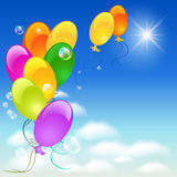 Balloons in the sky. Balloons, sky, sun and clouds Royalty Free Stock Photography