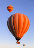 Balloons in the sky at sunrise Stock Photos