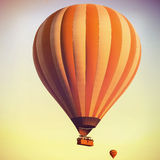 Balloons in the sky at sunrise. Balloons in the sky over Cappadocia at sunrise. Vintage retro style royalty free stock photography