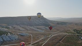 Balloons soar over the valley amid protruding mountain ranges, the morning sun draws long shadows Crimea White Rock