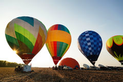Balloons start fly on fields, Royalty Free Stock Photo