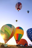 Balloons start fly on fields, hills in summer Royalty Free Stock Photography
