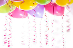 Balloons with streamers for birthday party celebration. Isolated on white background Stock Image